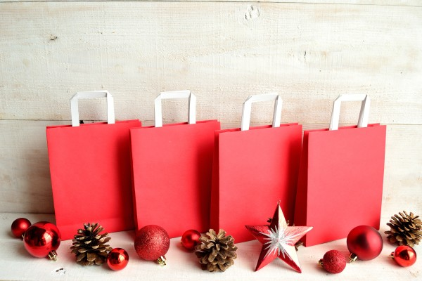 Red shopping bags with Christmas ornaments